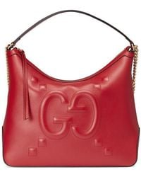 7cc326f7579 Gucci - Leather Tote With Embossed GG In Red - Lyst