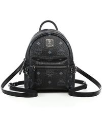 MCM - Mini Stark Studded Coated Canvas Backpack - Lyst