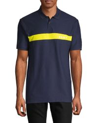 6e85b803 DKNY - Regular-fit Moisture-wicking Colorblocked Logo-stripe Polo Shirt -  Lyst