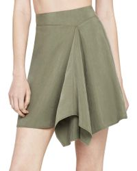 BCBGeneration - Asymmetrical Faux-wrap Mini Skirt - Lyst