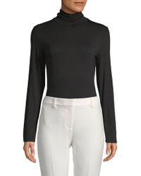 Donna Karan - Classic Turtleneck Bodysuit - Lyst