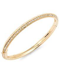 Adriana Orsini - Clear Crystal & Gold Bangle Bracelet - Lyst