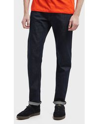 Lacoste - Slim Tapered Croc Jeans - Lyst