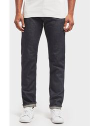 Lacoste - Slim Stretch Denim Tapered Jeans - Lyst