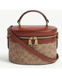 COACH - Trail Crossbody Bag In Brown Signature Coated Canvas - Lyst
