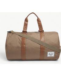 Herschel Supply Co. . Woodland Camo Novel Woven Duffel Bag in Green ... e6b9344691a78