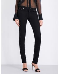 Givenchy - Star-printed Low-rise Skinny Jeans - Lyst