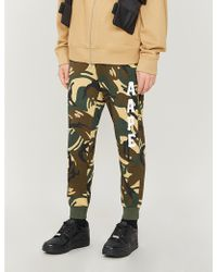 4db0cbcb Aape By A Bathing Ape Joggers With Print in Black for Men - Lyst