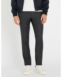 Sandro - Alpha Pinstriped Relaxed-fit Tapered Wool Trousers - Lyst