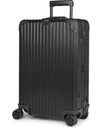 Rimowa - Topas Stealth Four-wheel Cabin Suitcase 68cm - Lyst