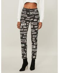 Moschino - Slogan-print Skinny Mid-rise Jeans - Lyst
