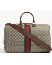 bb288d304a9 Gucci - GG Supreme Logo-print Canvas And Leather Holdall - Lyst