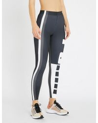 PUMA - Ambition Logo-print Stretch-jersey Leggings - Lyst