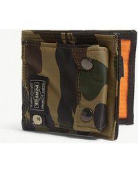 8edf977cda6 Lyst - A Bathing Ape Porter 1st Camo Small Nylon Wallet in Green for Men