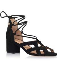 b87df899ba00 MICHAEL Michael Kors Mirabel Leather Heeled Sandals in Black - Lyst