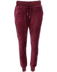 181f80bc1adc PUMA - Fenty By Rihanna Velour Fitted Track Pant - Lyst