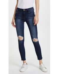 FRAME - Le High Skinny Jean With Raw Edge Slit Rivet - Lyst
