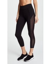 Michi - Stardust Crop Leggings - Lyst