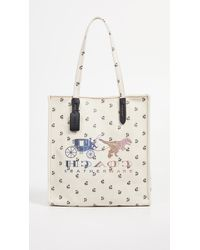 d48dc845cd57 COACH - Reverse Rexy   Carriage Canvas Tote - Lyst
