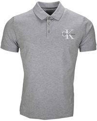 Calvin Klein - Polo manches courtes gris pour homme hommes Polo en Gris - Lyst