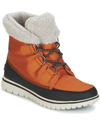 Sorel - Cosy Carnival Women's High Boots In Brown - Lyst