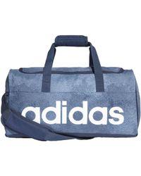 adidas - Sac en toile Linear Performance Petit format femmes Sac de sport en bleu - Lyst
