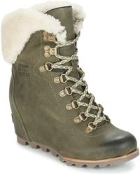 46bd3160c7f UGG Carmine Shearling-Lined Leather Wedge Ankle Boots in Brown - Lyst