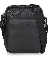 Calvin Klein - Multi Task Mini P Reporter Men s Pouch In Black - Lyst 0b0b939e76f78