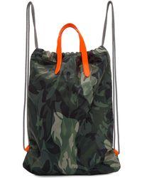 Alexander McQueen - Sac a dos motif camouflage et cordons coulissants vert et orange - Lyst
