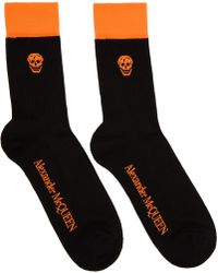 Alexander McQueen - Black And Orange Stripe Skull Socks - Lyst