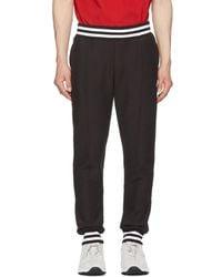 1e6d3bfaa4e3 Lyst - Champion Black Side Logo Lounge Pants in Black for Men