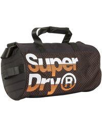 Superdry - Black/hazard Orange Nue Wave Lineman Barrel Bag - Lyst