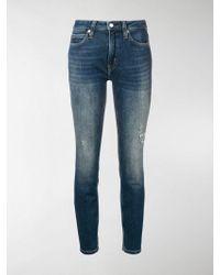 Calvin Klein - Distressed Skinny Jeans - Lyst