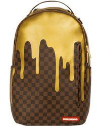 Sprayground - Gold Checkered Drips Backpack - Lyst