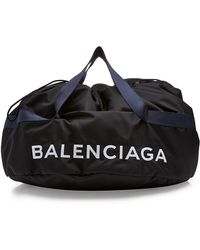 Balenciaga - Printed Wheel Bag S With Leather - Lyst