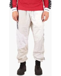 49473c9b55a Lyst - Nike Taped Poly Track Pants in Blue for Men