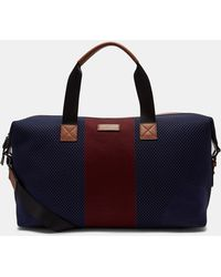 Ted Baker - Trains Knitted Color-block Duffel Bag - Lyst