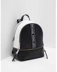 55ad8fffe1be Michael Kors Rhea Medium Logo Tape Backpack in White - Lyst