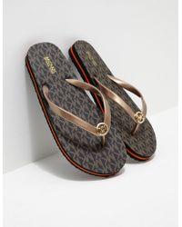 2cb8801e54553f Lyst - Women s Michael Kors Flip-flops On Sale