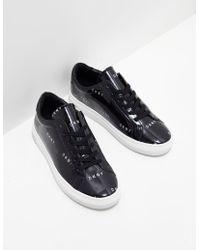 68e945f953c Dkny Banner Bow Slip On Sneakers - Black in Black - Lyst