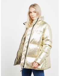 91c240fecf5 Tommy Hilfiger Tommy Icons Padded Puffer Gold Jacket in Metallic - Lyst