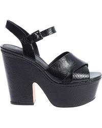 fb7e38d059f Lyst - Michael Kors Divia Embossed-leather Platform Sandal in Gray