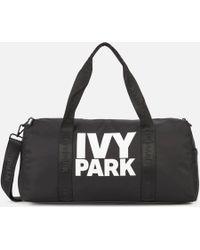 429b9cd865 Ivy Park - Stacked Logo Gym Barrel Bag - Lyst