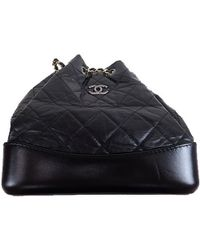 Chanel - Quilted Leather Cc Chain Drawstring Backpack - Lyst