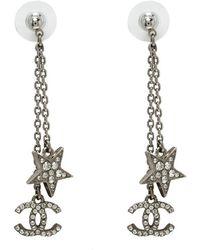Chanel - Cc Star Crystal Tone Long Earrings - Lyst