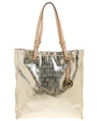 15e84c52f383 MICHAEL Michael Kors - Pale Gold Monogram Patent Leather Jet Set North  South Tote - Lyst