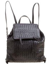 Bottega Veneta - Dark Intrecciato Leather Drawstring Flap Backpack - Lyst