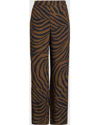 b6c2ddc7c41c Étoile Isabel Marant Apolo Cropped Zebra-print Corduroy Skinny Pants in Red  - Lyst