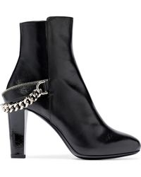 914ff99fc26735 Balmain Chain-embellished Shearling-lined Leather Ankle Boots in ...
