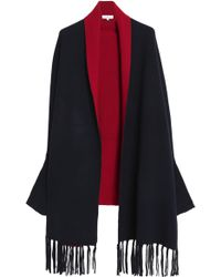 Sandro - Fringe-trimmed Stretch-knit Cape - Lyst